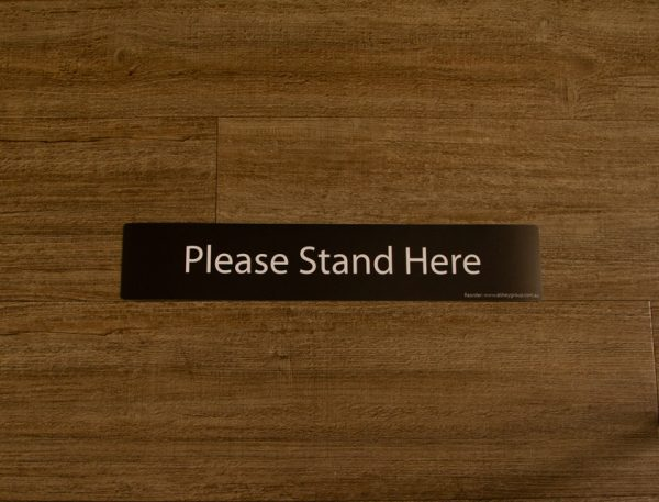 Black Please Stand Here Sticker